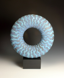 Dark blue disc on stone base 44 cm h inc base 36 cm across 11 dep inc base